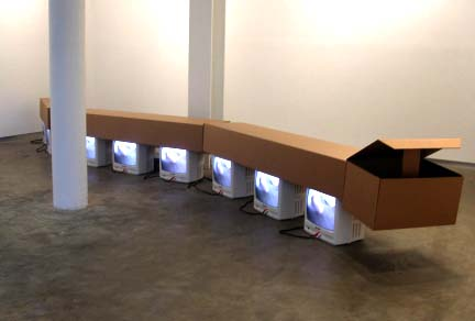Almost Worm II 2002 Cardboard, televisions, dvd, dvd player 21 x 222 x 16 inches