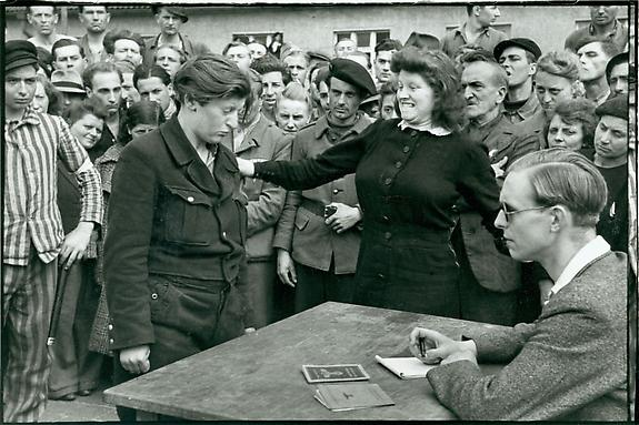 Gestapo Informer Recognized by a Woman She Had Denounced, Deportation Camp, Dessau, Germany, 1945