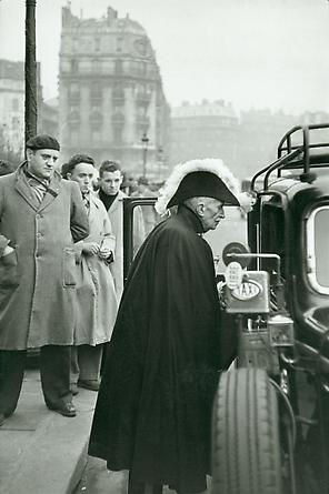 A member of the French Academy on his way to Notre-Dame, c. 1955