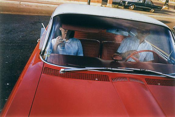 William Eggleston Untitled (Couple in Red Car at Drive-In Restaurant), Memphis, TN, 1965-68 [From Dust Bells 2]