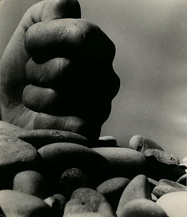 Clenched Hand on Rocks