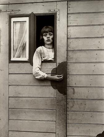 August Sander Girl in Fairground Caravan, 1926-32 © Die Photographische Sammlung/SK Stiftung Kultur, August Sander Archiv, Köln; ARS, NY