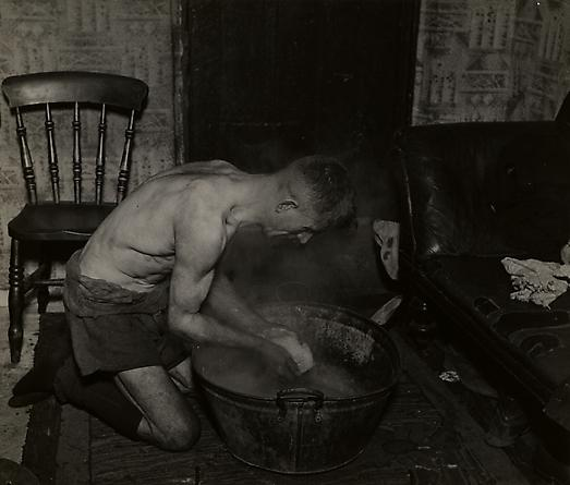Coal Miner Washing Himself After Work, c. 1937