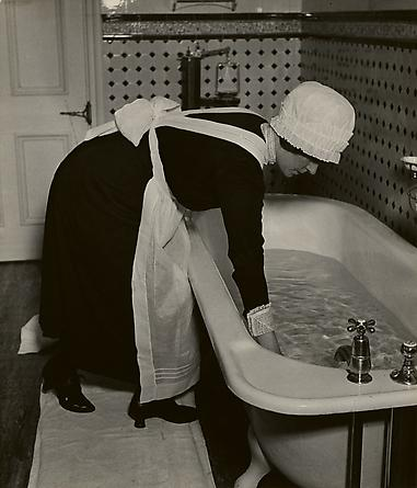 Parlourmaid Preparing a Bath before Dinner, c. 1937