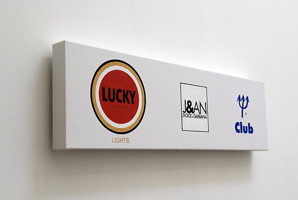 ELIJAH BLUE  Lucky-Jean-Club (Legend), 2010  Inkjet, fiber and acrylic on canvas on panel  10 x 36 inches