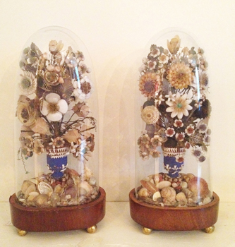 <font size=3>INDIAN SUMMER - <font size=2>A pair of Regency shell floral dioramas under hand-blown glass domes on wooden circular plinths.