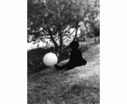 Untitled (Child Sitting with a Ball) 2000 c-print 77.5 x 62 cm