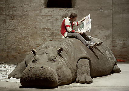 "<i>Hope Hippo</i> 2005 Mud, Whistle, Daily Newspaper, Reader.  192"" x 72"" x 60""  Installation View: ""Always a Little Further"" 51st International Art Exhibition, la Bienal di Venezia  Photo:  Giorgio Boata"