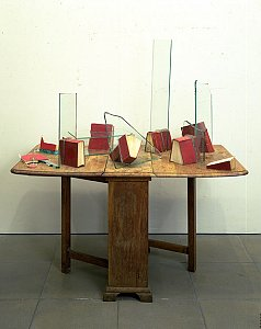 John Latham  <i>Table with the Law, </i>1988 Table with glass and ten books 75 x 33 x 76 cm
