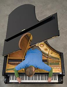 "<i>Stop, Repair, Prepare: Variations of Ode to Joy for a Prepared Piano</i> 2008   Prepared Bechstein Piano, Pianist (Amir Khosrowpour, depicted) 81"" Long  Installation view: Museum of Modern Art, New York Photo: Marino Solokov"