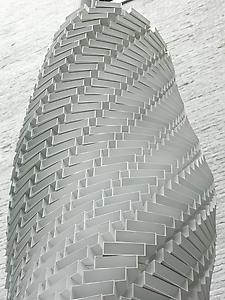 Shirazeh Houshiary  <i>White Shadow,</i> 2005 Aluminium bricks and steel cable Detail height 405 cm; ellipse 66 cm x 47 cm
