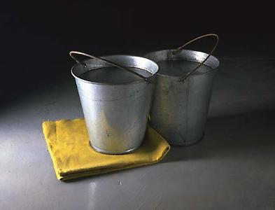 Richard Wentworth  <i>Unmatched Pair (Jerusalem),</i> 1986 Galvanised steel and linen 46 x 61 x 39 cm