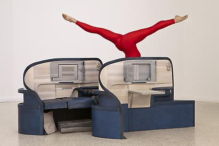 "<i>Body in Flight (Delta)</i> 2011 Stained Wood, gymnasts (Sadie Wilhelmi, USA Gymnastics, depicted) Installation view: ""Gloria"" US Pavilion, presented by the Indianapolis Museum of Art, 54th International Art Exhibition, La Bienal di Venezia Photo: Andrew Bordwin"