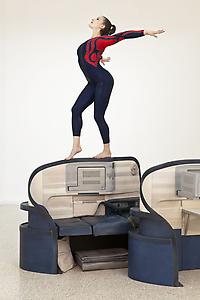 "<i>Body in Flight (Delta)</i> 2011 Stained Wood, gymnasts (Rachel Salzman, USA Gymnastics, depicted) Installation view: ""Gloria"" US Pavilion presented by the Indianapolis Museum of Art, 54th International Art Exhibition, La Bienal di Venezia Photo: Andrew Bordwin"