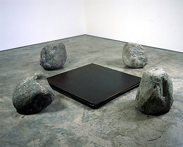 <i>Relatum - Discussion,</i> 2003 Four iron plates and four stones Stones 50 x 60 cm