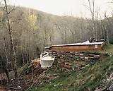 Joel  Sternfeld An Earthship at Earthaven Ecovillage, Black Mountain, North Carolina, April 2005. 2005 C-print Print: 26 1/2 x 33 1/4 inches