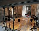 "Janet Cardiff <i>The Forty Part Motet (A reworking of ""Spem in Alium"" by Thomas Tallis 1573)</i>, 2001 40 loud speakers mounted on stands, placed in an oval, amplifiers, playback computer  Duration: 14 min. loop with 11 min. of music and 3 min. of intermission"