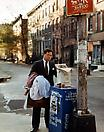 Joel Sternfeld <i>A Lawyer with Laundry, New York, New York, October 1988</i> from <i>Stranger Passing</i> Ektacolor print mounted on plexi Edition of 7 with 3 artist's proofs 36 1/4 X 45 3/4 inches  (92.08 X 116.21 cm)