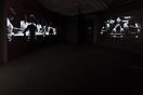 Lorna Simpson <i>Chess</i>, 2013 HD video installation with three projections, black and white, sound 10 minutes, 25 seconds Musical composition and performance by Jason Moran Installation view: Jeu de Paume, Paris, 2013 Courtesy of the artist