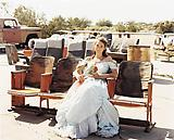 Joel  Sternfeld Queen of the Prom, the Range Nightclub, Slab City, California, March 2005. 2005 C-print Print: 26 1/2 x 33 1/4 inches