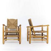 image Charlotte Perriand - Pair of rush armchairs / SOLD
