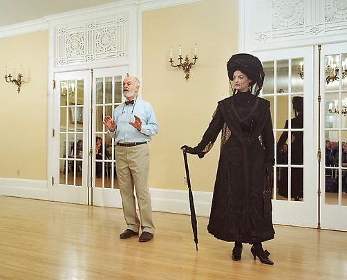 <i>Ivan Sayers, costume historian, lectures at the University Women's Club, Vancouver, 7 December 2009. Virginia Newton-Moss wears a British ensemble c. 1910, from Sayers' collection</i>, 2009 Image