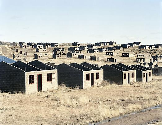 <b>Incomplete houses, part of a stalled municipal development of 1000 houses.  The allocation was made in 1998, building started in 2003.  Officials and a politician gave various reasons for the stalling of the scheme: shortage of water, theft of materials</b>, 2006 Image