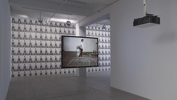 BRUCE NAUMAN <b>Walking in an exaggerated manner around the perimeter of a square</b>, 1968  STEVE MCQUEEN <b>Portrait as an Escapologist</b>, 2006 Image