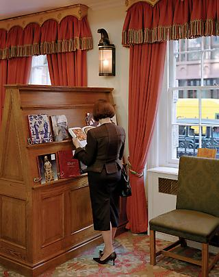 JEFF WALL <b>A woman consulting a catalogue</b>, 2006 Image