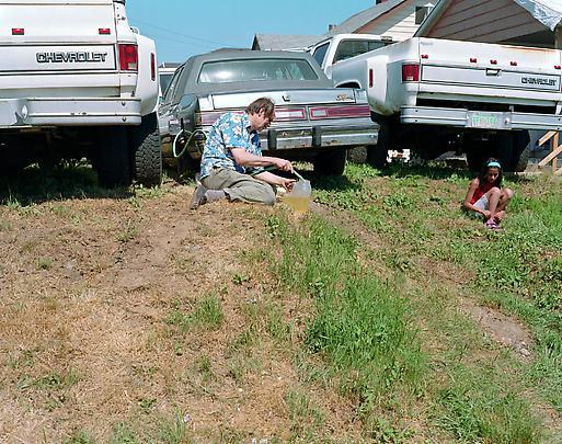 <b>Siphoning fuel</b>, 2008 Image