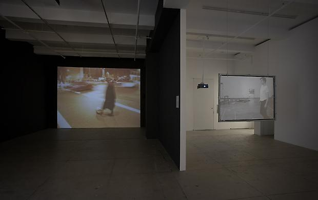 Installation view North Gallery (from left to right):  DAVID HAMMONS <b>Phat Free</b>, 1995/1999  BRUCE NAUMAN <b>Walking in an exaggerated manner around the perimeter of a square</b>, 1968 Image