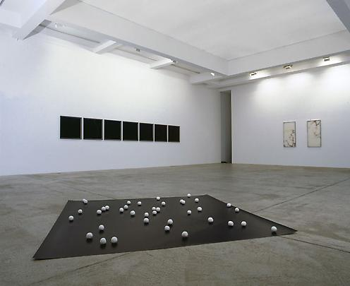 Installation view  (from foreground to background and from left to right):  <b>Chalk Balls</b>, 2006  <b>Lightning Series I-VII</b>, 2007 Image