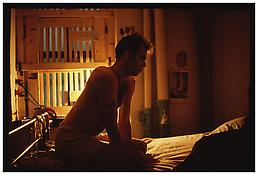 <i>Brian on my bed with bars, NYC</i> 1983 Cibachrome 30 x 40 inches; 76 x 102 cm