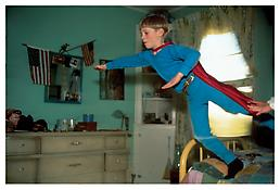 <i>Dewey as Superman, Providence, RI</i> 1991 Cibachrome 30 x 40 inches; 76 x 102 cm
