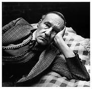 <i>William Burroughs, Reclining</i> 1975 Gelatin-silver print 14 1/2 x 14 3/4 inches; 37 x 37.5 cm