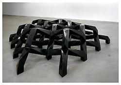 Tony Smith <i>Smug</i> 1973 Cast bronze, black patina 36 x 192 x 140 inches; 92 x 488 x 356 cm
