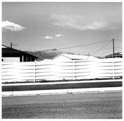 Robert Adams <I>Pikes Peak, Over the Top of a Fence, and New Houses, Colorado Springs, Colorado</i> 1968-1971 Gelatin silver print 13 x 11 inches; 33 x 28 cm