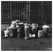 <i>Trash, New York</i> 1985 Gelatin-silver print 14 5/8 x 14 5/8 inches; 37 x 37 cm