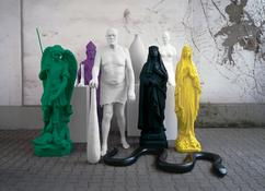 <i>Figurengruppe / Group of Figures</i> 2006-2008 An installation of nine elements: <i>Gartenskulptur (Torso) / Garden Sculpture (Torso)</i>, 2006/08. Polyester, paint. 78 3/4 x 15 3/4 x 15 3/4 inches; 200 x 40 x 40 cm.  <i>Gartenskulptur (Vase) / Garden Sculpture 2 (Vase)</i>, 2006. Polyester, paint. 78 3/4 x 15 3/4 x 15 3/4 inches; 200 x 40 x 40 cm.  <i>Gartenskulptur (Skelettfüsse) / Garden Sculpture 3 (Skeleton Feet)</i>, 2006. Polyester, paint. 55 1/8 x 15 3/4 x 15 3/4 inches; 140 x 40 x 40 cm.  <i>Heiligenfigur (St. Michael) / Figure of a Saint (St. Michael)</i>, 2008. Polyester, paint. 66 1/2 x 26 x 22 1/2 inches; 169 x 66 x 57 cm.  <i>Madonnenfigur / Madonna Figure</i>, 2007. Polyester, paint. 67 x 13 3/8 x 15 3/4 inches; 170 x 34 x 40 cm.  <i>Riese / Giant</i>, 2008. Polyester, paint. 76 3/4 x 37 3/8 x 27 1/2 inches; 195 x 95 x 70 cm.  <i>Schlange / Snake</i>, 2008. Epoxy resin, lacquer. 67 x 27 1/2 x 4 1/2 inches / 170 x 70 x 12 cm.  <i>Heiligenfigur (St. Katharina) / Figure of a Saint (St. Katharina)</i>, 2007. Polyester, paint. 67 x 19 3/4 x 15 3/4 inches; 170 x 50 x 40 cm.  <i>Heiligenfigur (St. Nikolaus) / Figure of a Saint (St. Nicholas)</i>, 2008. Polyester, paint. 74 x 23 1/4 x 15 1/3 inches; 188 x 59 x 39 cm.