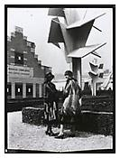 Jan and Joël Martel / Robert Mallet-Stevens, <i>Models wearing dresses by Sonia Delaunay photographed in front of the concrete trees by the Martel Brothers</i>, 1925, Image: 7 7/8 x 5 7/8 inches; 20 x 15 cm, Sheet: 8 1/4 x 6 1/4 inches; 21 x 16 cm, Exhibition print