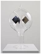 <i>Johns Radiometer</i> 2012 Borosilicate glass 8330/8250, vacon 11, wolfram, mica, noble gas, carbon soot 25 1/4 x 13 5/8 inches; 64 x 35 cm