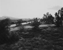 <I>Looking toward Los Angeles, Interstate 10,  west edge of Redlands, California</i> 1982 Gelatin silver print Image: 9 x 11 1/4 inches; 23 x 29 cm Sheet: 11 x 14 inches; 28 x 36 cm