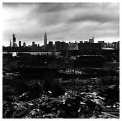 <i>Queens Landscape with New York Skyline</i> 1984 Gelatin-silver print 14 5/8 x 14 5/8 inches; 37 x 37 cm
