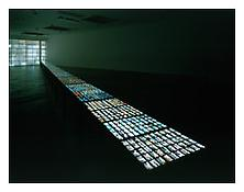 "<i>Visible World</i> 1986-2001 15 light tables with 3000 small format photographs 92' x 2'  3 1/4"" x 2'  11 1/2""; 2805 x 69 x 83 cm"