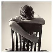 <i>David Wojnarowicz with Chair</i> 1983 Gelatin-silver print Sheet: 13 5/8  x 10 7/8 inches; 35 x 28 cm