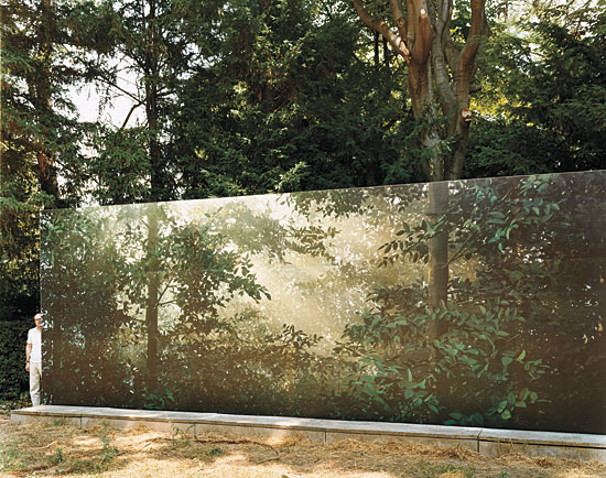 Thomas Demand installing one of his artworks at the gardens at the Venice Biennale. Photo by Jason Schmidt.