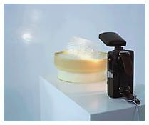 Peter Fischli / David Weiss <i>Son et Lumiere</i> 1990 Flashlight, turntable, plastic cup and adhesive tape