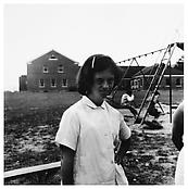 <i>Girl with Hand on Her Hip, Southbury</i> 1957 Gelatin-silver print Image: 9 5/8 x 9 1/2 inches; 24 x 24 cm Sheet: 14 7/8 x 11 inches; 38 x 28 cm