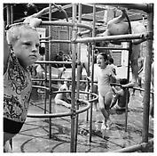 <i>Playground, Southbury</i> 1957 Gelatin-silver print Image: 13 1/8 x 13 1/4 inches; 33 x 34 cm Sheet: 17 x 14 inches; 43 x 36 cm