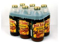 <i>Molasses Six Pack</i> 1998 Six glass bottles of molasses with plastic holder 6 3/4 x 7 3/4 x 5 1/4 inches; 17 x 20 x 13 cm